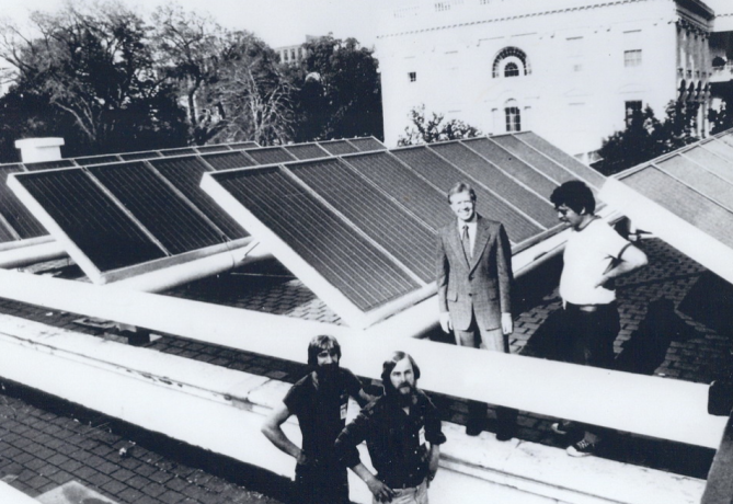 President Jimmy Carter at installation of solar panels on White House. President Ronald Reagan removed them in 1980, the kick of to an awful decade in American history.
